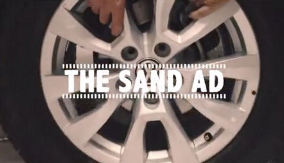 The writing is on the… sand!